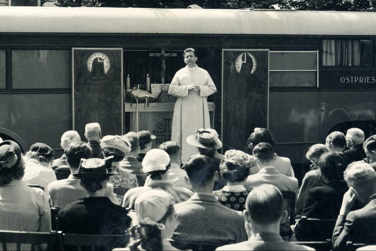 Father Werenfried during one of his homilies at the chapel-truck.