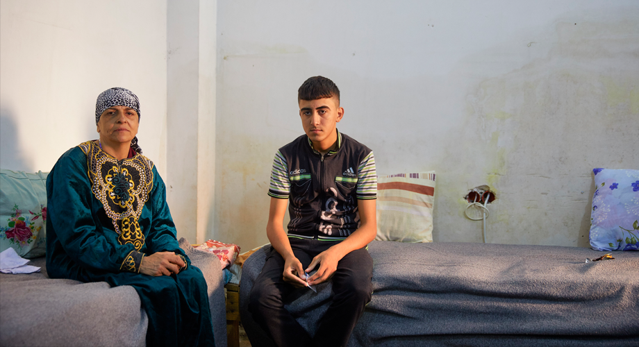 Jandark Behnam Mansour Nassi, widow with her 16-year-old son, Ismail – internally displaced people (IDPs) from Bartella, one of the Christian villages in the Nineveh Plains now supported by ACN in Erbil, northern Iraq © Aid to the Church in Need/Jaco Klamer