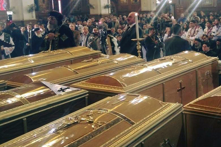 A funeral in Egypt, after pilgrims killed by Daesh (ISIS) extremists.