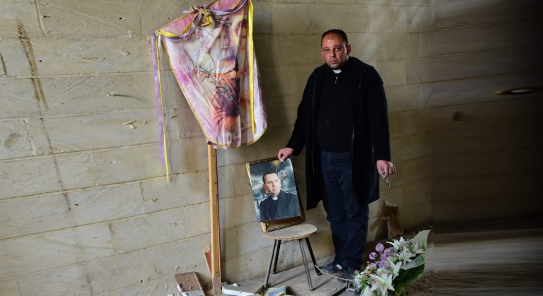 Fr Thabet Habeb Mansur wept to see what extremists did to Fr Ragheed Ganni's grave.