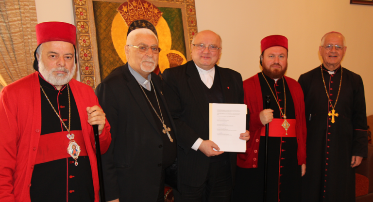 Archbishop Timothaeus Mosa Alshamany, Archbishop Yohanna Petros Mouche, Fr Andrzej Halemba, Metropolitan Nicodemus Daoud Matti Sharaf, and Bishop Mikha Pola Maqdassi – have formed the Nineveh Reconstruction Committee (NRC). (© Aid to the Church in Need)
