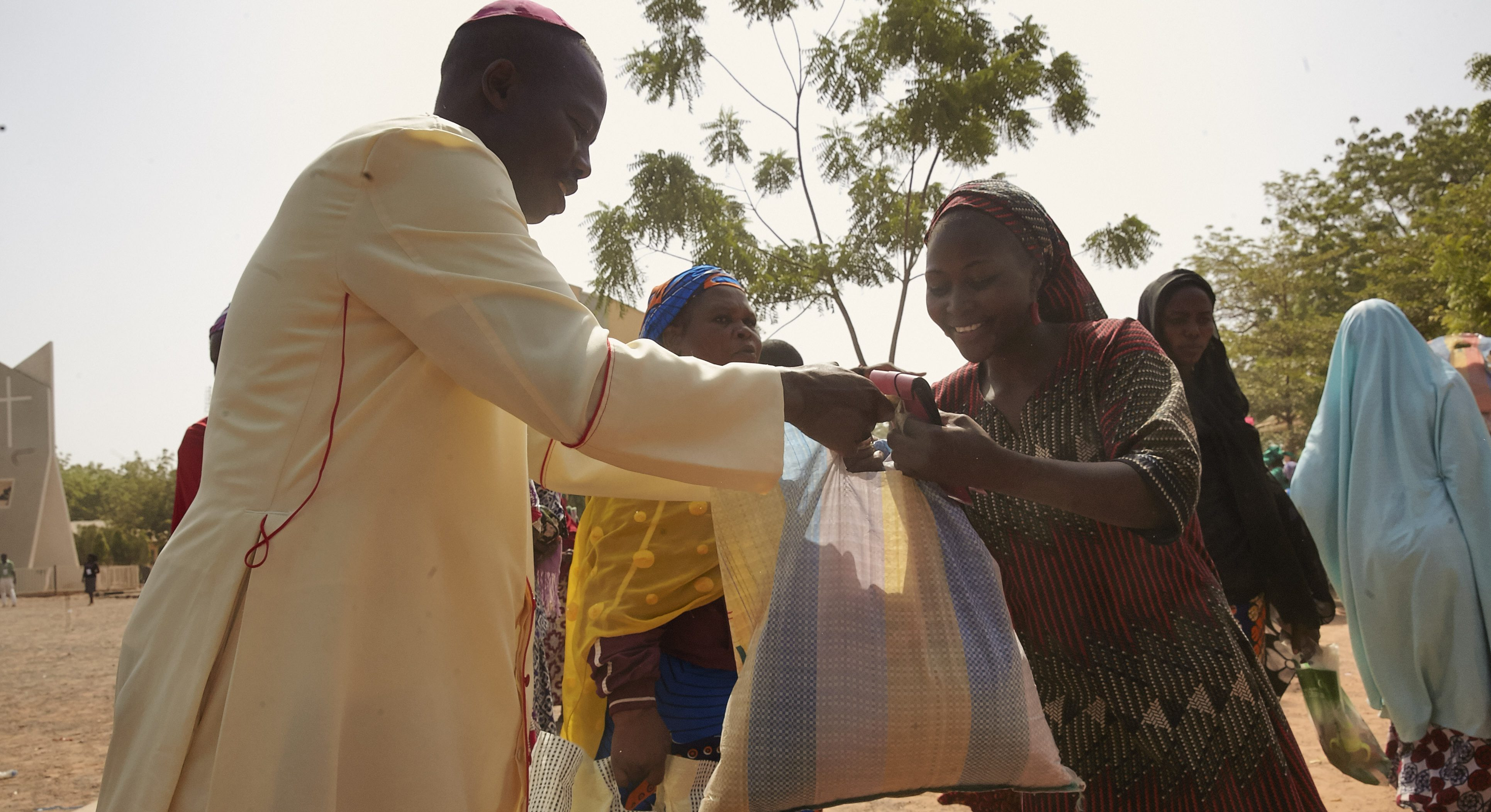 Nigeria, Yola, St Theresa's Cathedral Catholic Church with refugees IDP's food en goods distribution to people who lives with friends or relatives in Yola more than 3000 most woman came. Distrubution together with American University Nigeria   Photo Jaco Klamer 9-12-2015