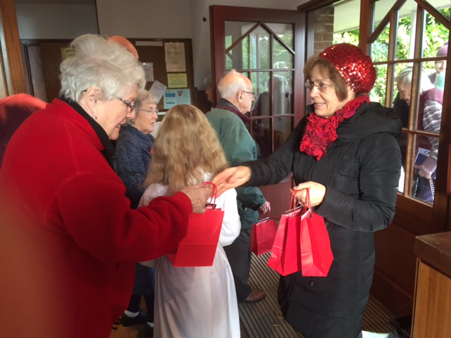 Handing out #RedWednesday bags Wendover
