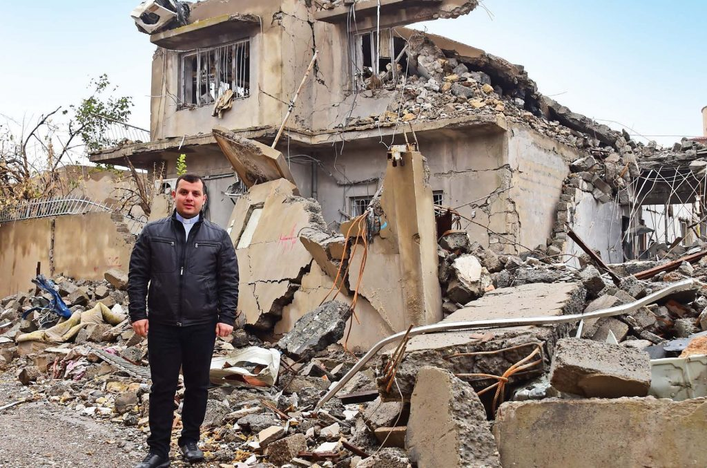 Chaldean priest Fr Steven Azabod surveys the devastation in Batnaya, a once flourishing town on the Nineveh Plains.