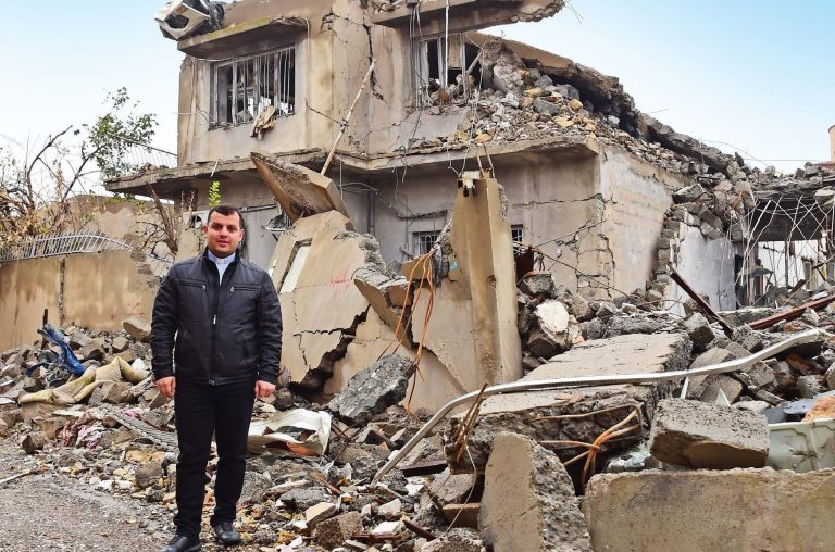 Chaldean priest Fr Steven Azabod surveys the devastation in Batnaya, a once flourishing town on the Nineveh Plains.