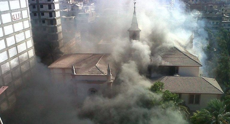 Smoke rises from the Good Shepherd Church