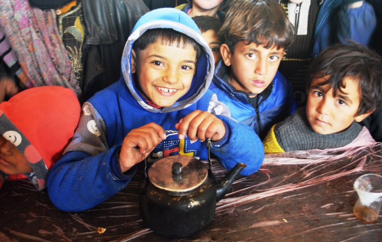 Children awaiting hot lunch at the Jibrin District Displacement Centre for people from East Aleppo, Syria_edited
