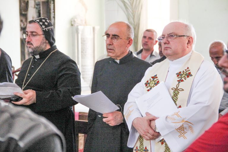 Fr Andrzej Halemba, Aid to the Church in Need's Middle East projects coordinator (right) with Syriac Catholic priest, Fr Georges Johola (centre) in the Middle East (© Aid to the Church in Need)