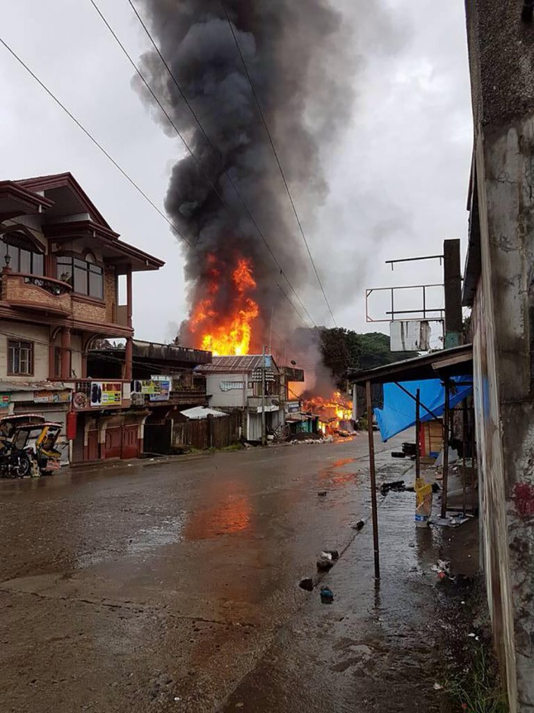 Fires in Marawi City on the first day of the extremists' siege. Image: Sittie Ainah U Balt/ACN.