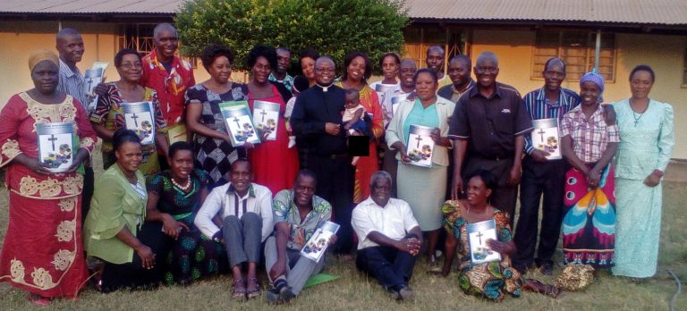Formation of marriage and family catechists in Zambia, priest with trained couples in Kabwe Diocese