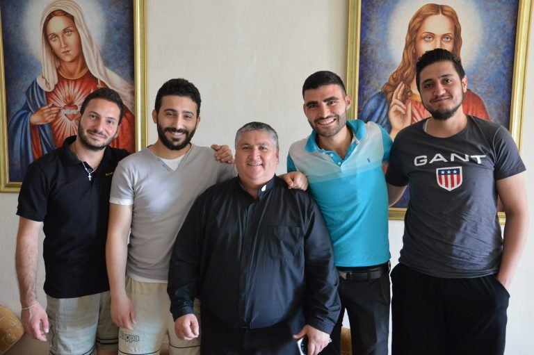 Father David Fernández with students in Aleppo, from left Weaam Panous, Bahe Betros, Antranik Kaspar and Robert Salibi (© Aid to the Church in Need)