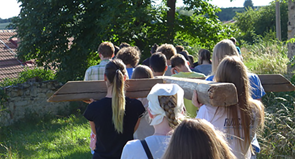 Young people in the Czech Republic walk the Stations of the Cross at the newly renovated Chemin Neuf monastery in Tuchomerice, 2016