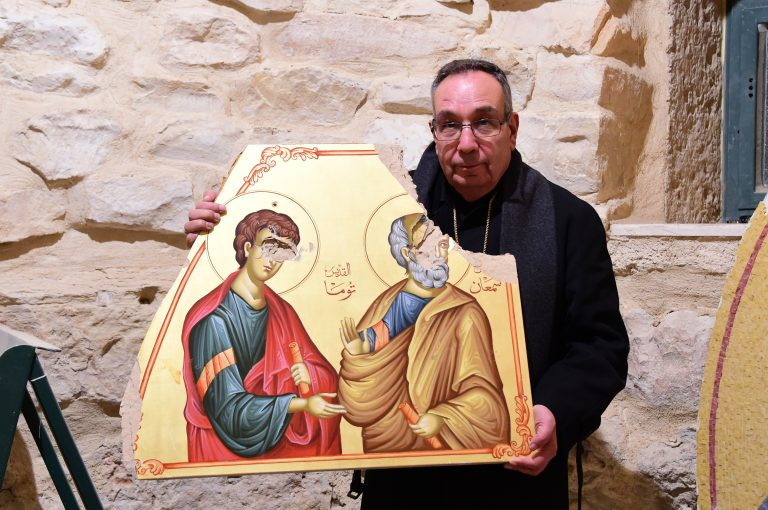 Melkite Archbishop Jean Abdou Arbach of Homs, Hama and Yabroud with an icon destroyed by Islamist militants among the rebels forces (© Aid to the Church in Need)