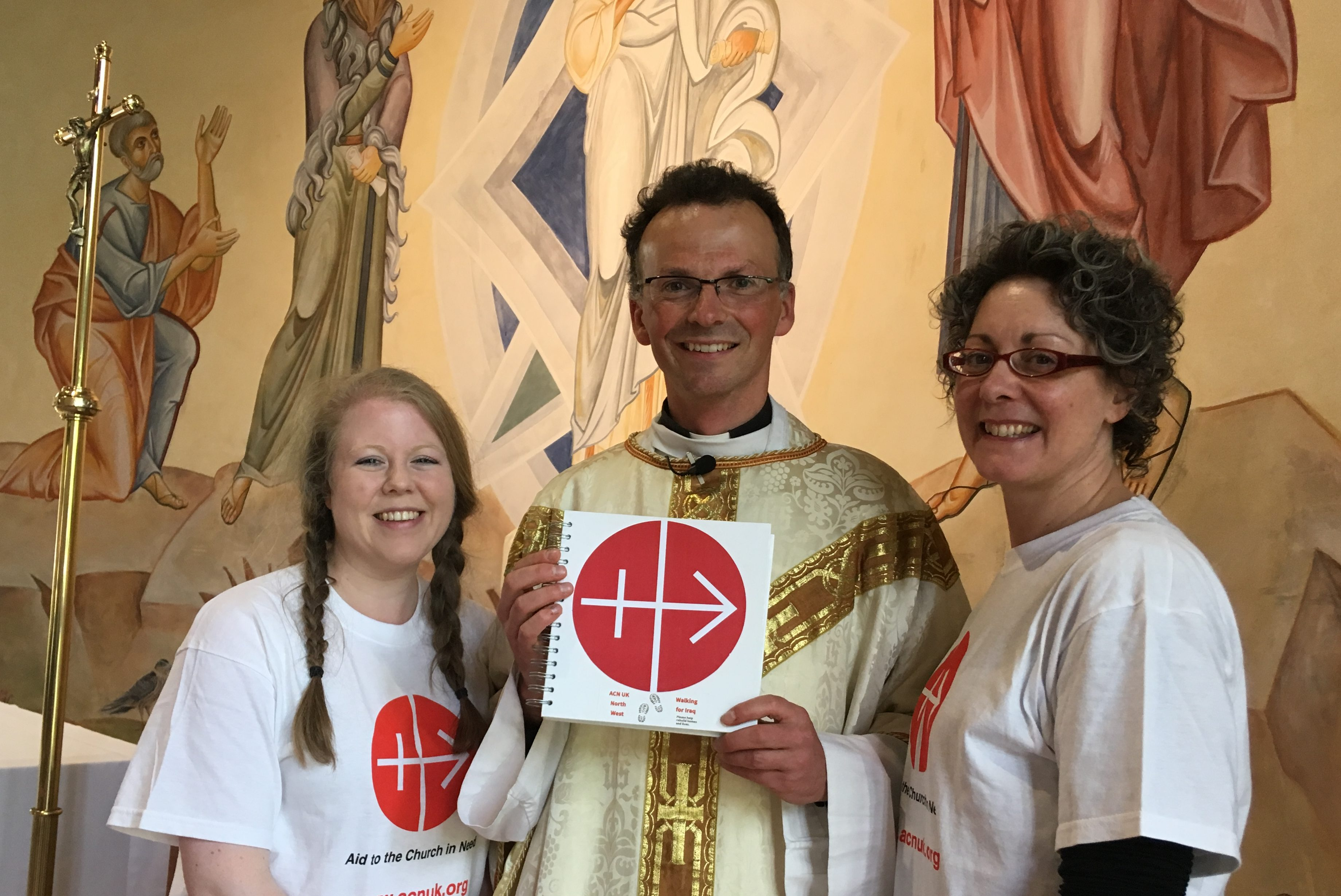 Father Philip Conner welcomes Bridget (left) and Caroline to the Catholic Chaplaincy at Lancaster University (© Aid to the Church in Need)