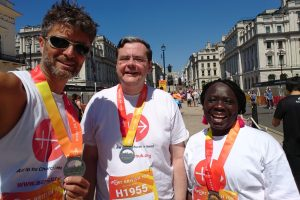 ACN supporters and 10K runners L-R Sebastian, Fr Dominic and Harriet (© Aid to the Church in Need)