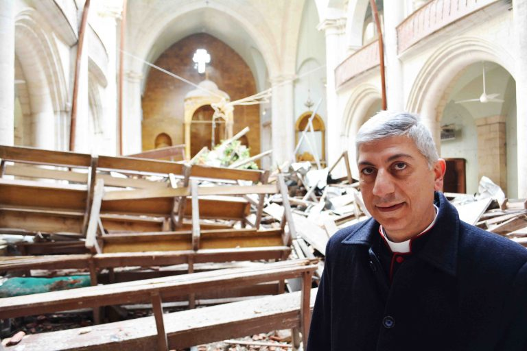 Maronite Archbishop Joseph Tobji in the bombed Maronite Cathedral in Aleppo's Old City