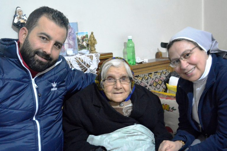 ACN project partner Sister Annie Demerjian with Lucine, aged 85, from Aleppo, Syria, and volunteer Fadi.