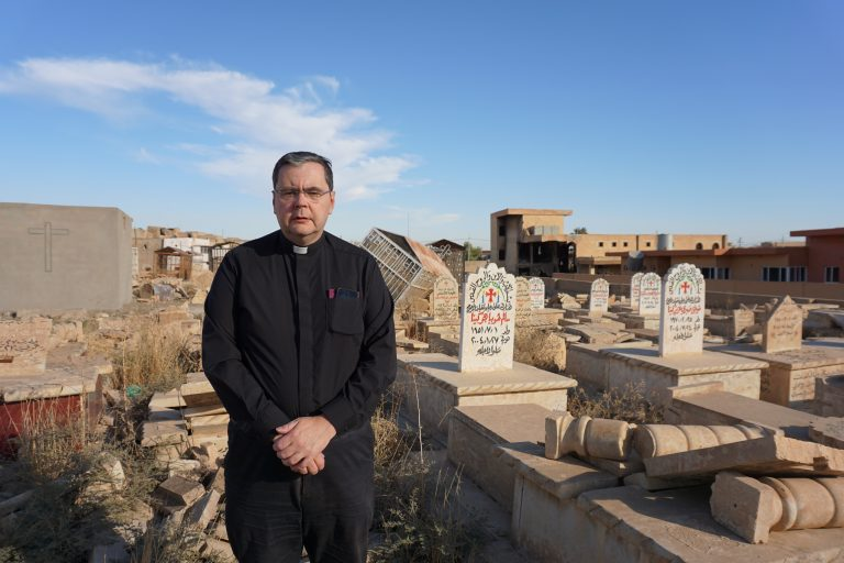 Father Dominic visits a destroyed grave yard in Iraq.