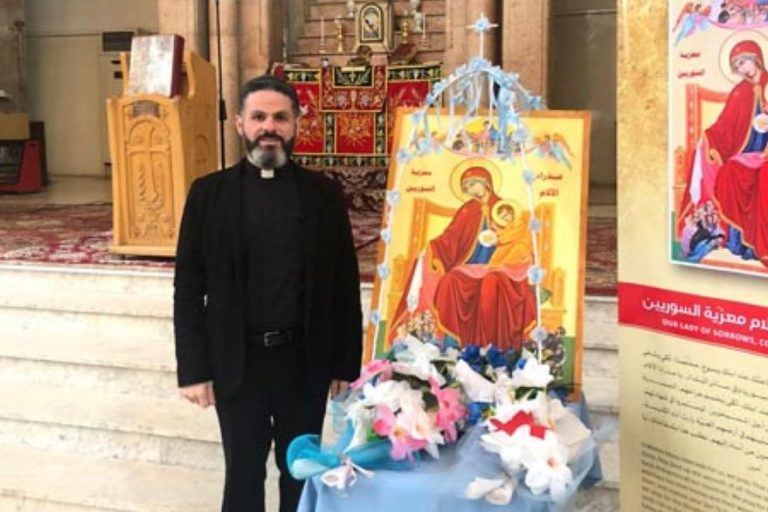 Father Charbel Eid Rizkallah and the icon (Credit: Aid to the Church in Need)