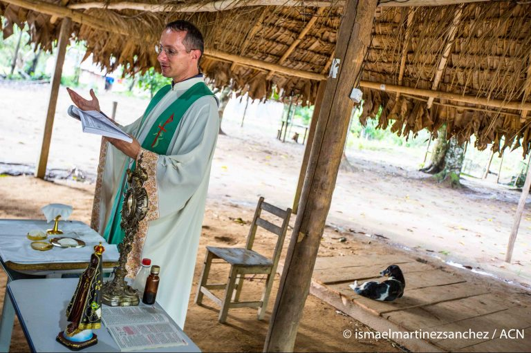 Father Adilson Selch, 41, during Mass in the indigenous village of Pé-de- Mutum. He is the parish priest of Castanheira, 50 km from Pé-de-Mutum by road and the last 6 km in canoe. From its parish in Castanheira, he serves the 34 Catholic indigenous communities of Juina, such as the Rikbaktsa tribe, although the most distant Indians he attends are 280 km and six hours by motorized canoe.