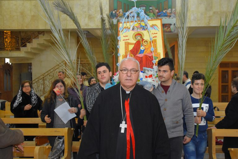 An icon procession is led by Chaldean Catholic Monsignor Nidal Thomas, Chaldean vicar of Hassake, north-east Syria