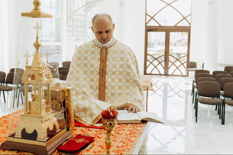 A Ukrainian Greek-Catholic priest in the Archeparchy of Ivano-Frankivsk celebrating the Divine Liturgy in an empty church because of the COVID-19 lockdown