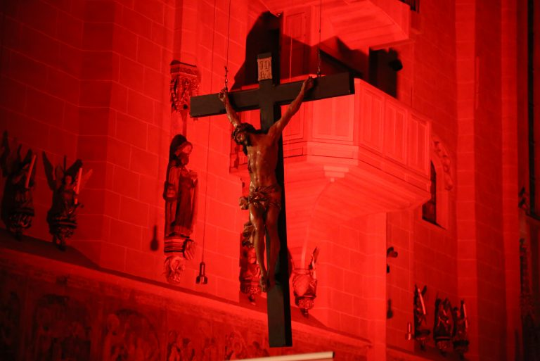 Red-lighted Cross at the