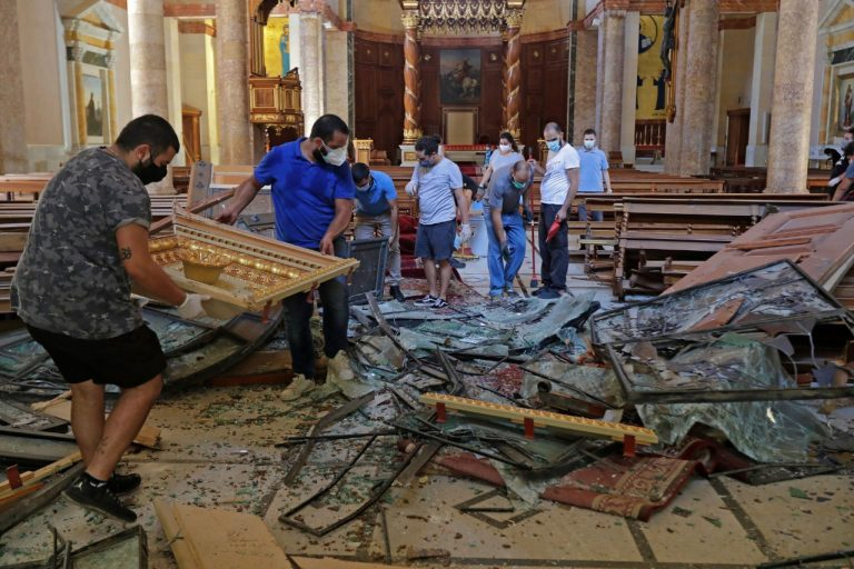 With pictures of young Christian volunteers helping in the wake of the last week's explosion (© Maronite/Beirut)