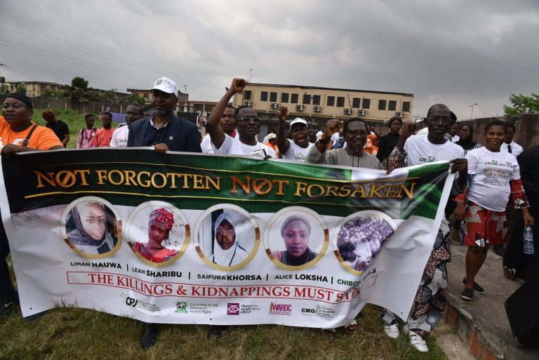 With image of protesting Nigerians (Credit: Catalyst for Global Peace and Justice)