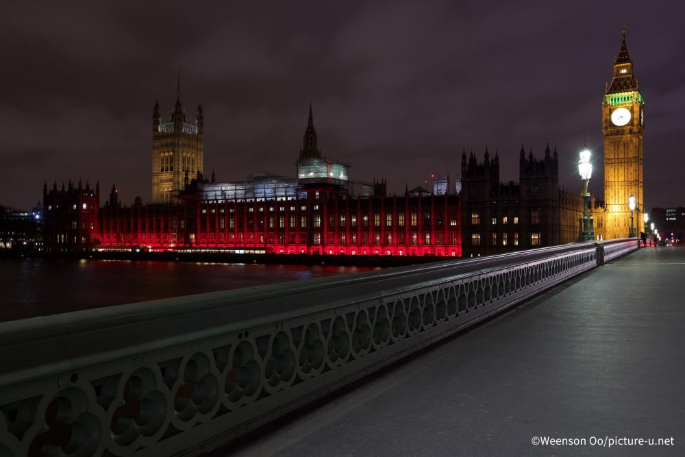 The Houses of Parliament lit red for #RedWednesday in 2016 (Credit: © Weenson OO/PICTURE-U.NET)