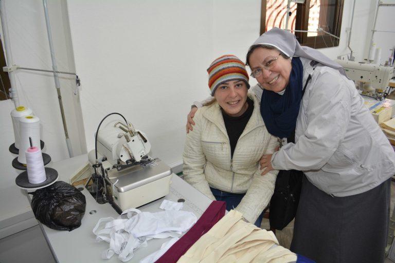 Sister Annie Demerjian with tailor Takla al Safadi in a workshop in Maaloula.