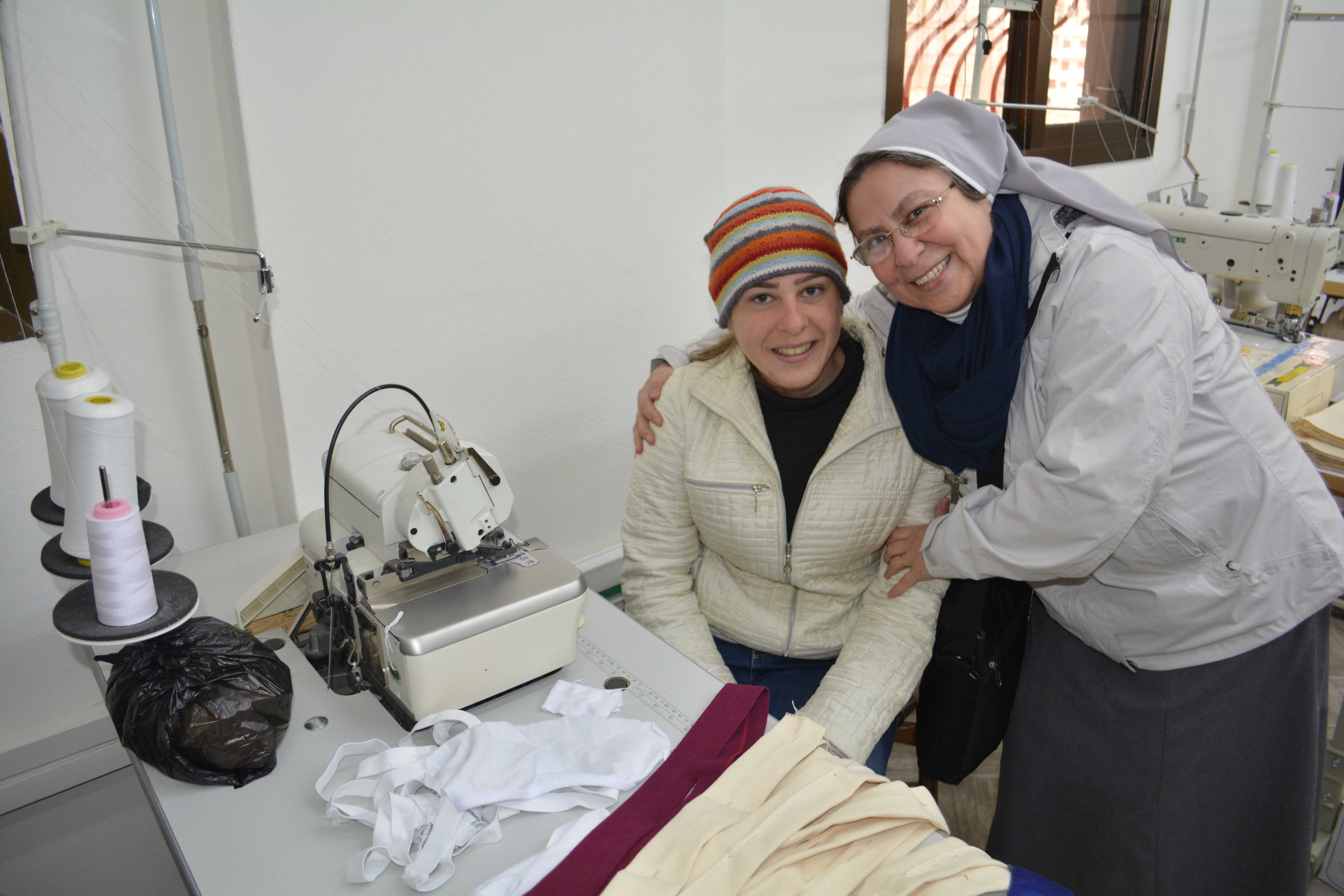 Sister Annie Demerjian with tailor Takla al Safadi in a workshop in Maaloula.