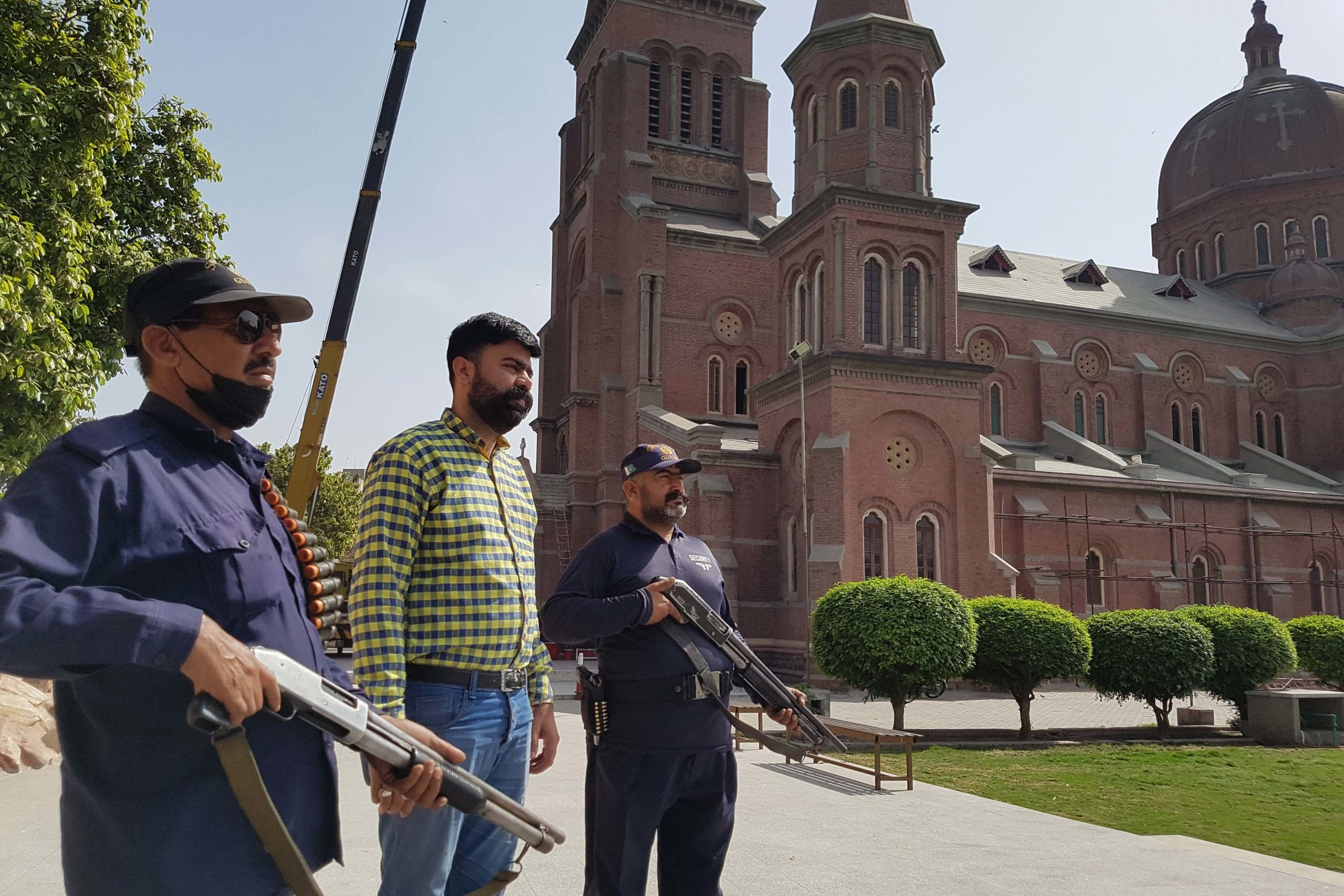 Pakistan, 2021: William Arif Khan and security guards at Sacred Heart Cathedral in Lahore.