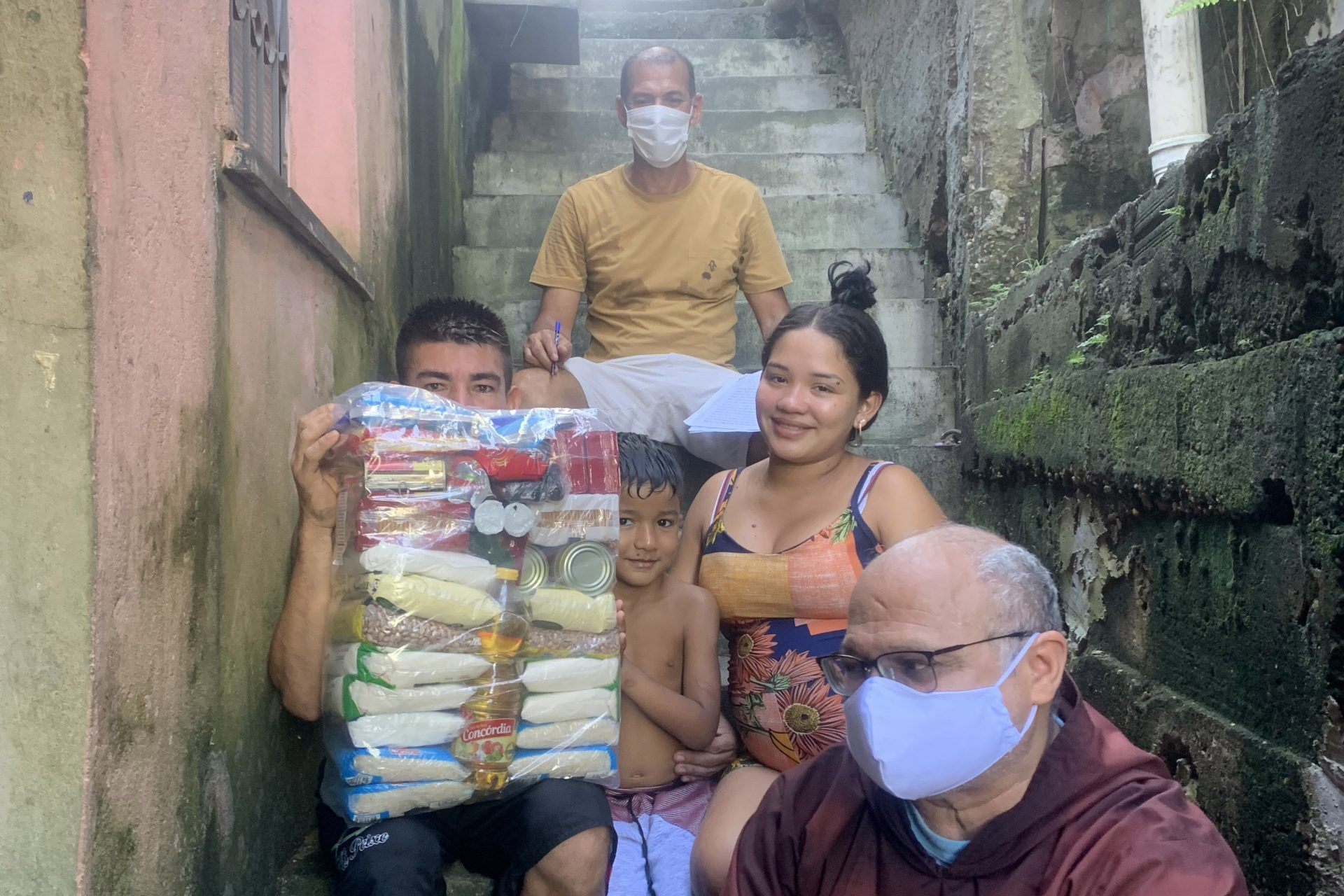 With image of Franciscan distributing food aid in Manaus, Brazil (© Aid to the Church in Need).
