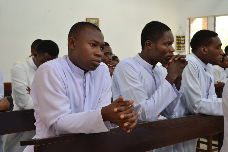 With picture of seminarians at prayer in Nigeria (Image © Aid to the Church in Need)