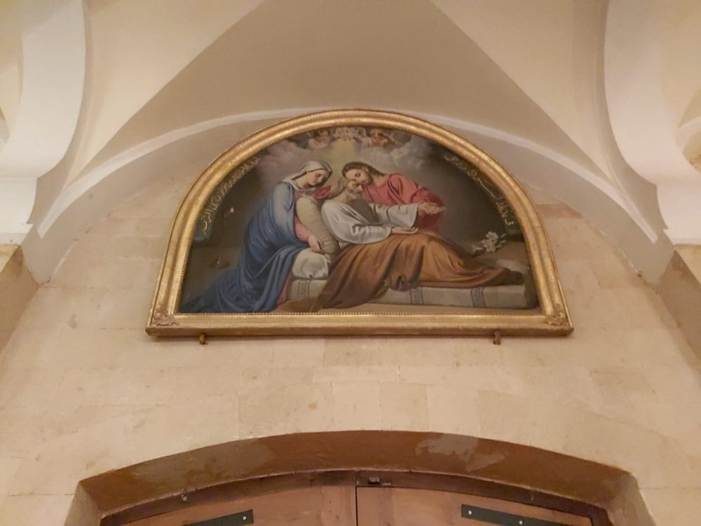 An image showing the Holy Family in the restored church.